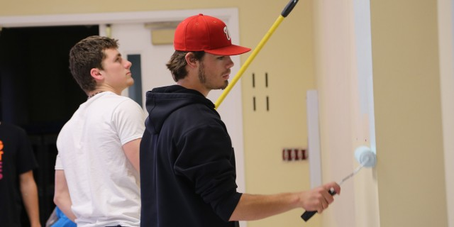 Students Weston Schroeder (Harper, Kan.) and Daulton Horton (Denton, Texas), paint at the Mennonite Central Committee Central States office (North Newton, Kan.) as part of their Larkfest service project. All on-campus students participated, with about 275 students at 35 service assignments.