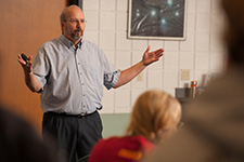 Nursing prof Gregg Schroeder lectures on the first day of BSN classes, fall 2015.