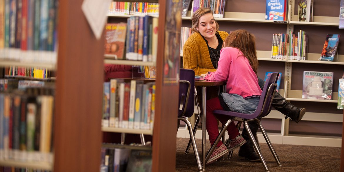 Caroline Riggenbach tutors a student at Hesston Public Library.