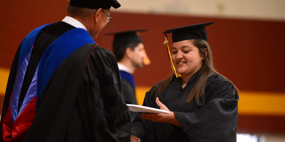 Emily Kauffman receives her diploma from President Howard Keim