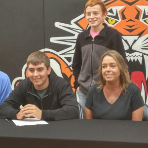 Sam Sowers signs a letter of intent to play golf at Hesston College.