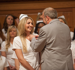 Taylor Schrag receives her nursing pin