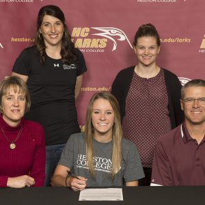 Kylie Brenneman signs a letter of intent to play volleyball for Hesston College.