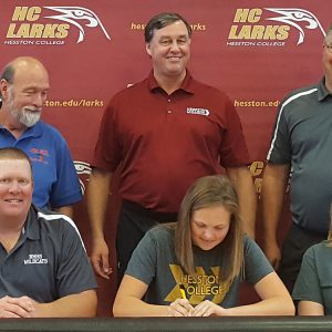 Kara Horton signs a letter of intent to play basketball for Hesston College.