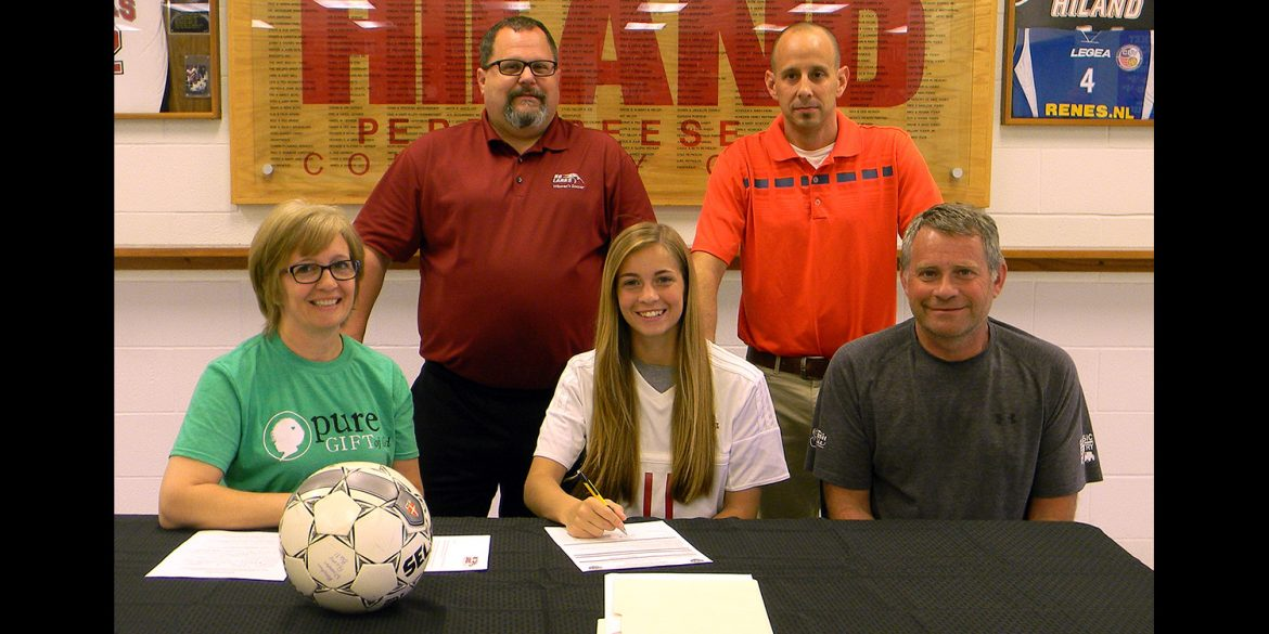 Lindsey Yoder signs a letter of intent to play soccer at Hesston College.