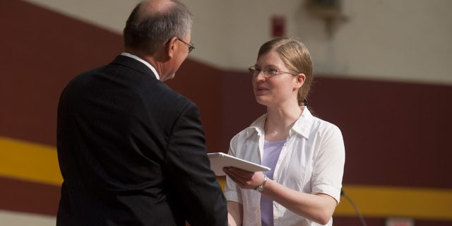 Sheralynn Neff receives her Hesston College diploma from President Howard Keim during Commencement in May 2011.
