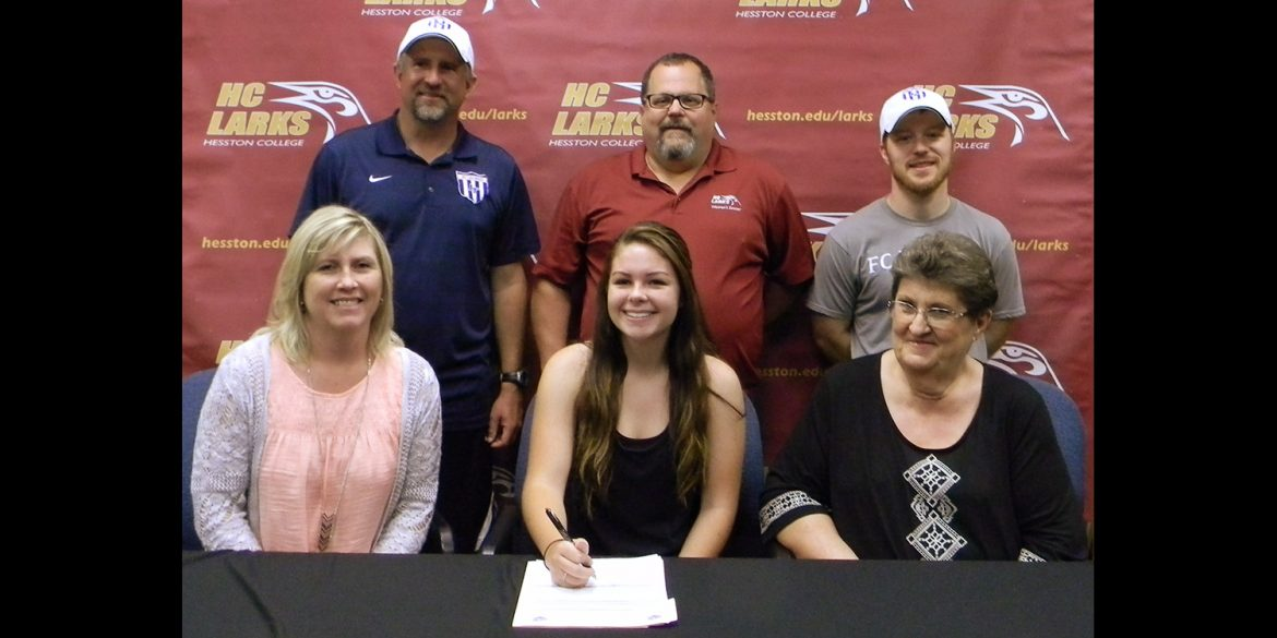 Payton Yehnert of Parker, Colo., signs with the Larks. Pictured front from left, Marjie Ybarra, Yehnert, grandmother Sandra McGuire. Back: Legend coach Gil Barkey, Hesston coach Bryan Kehr and Legend coach Michael Crosky.