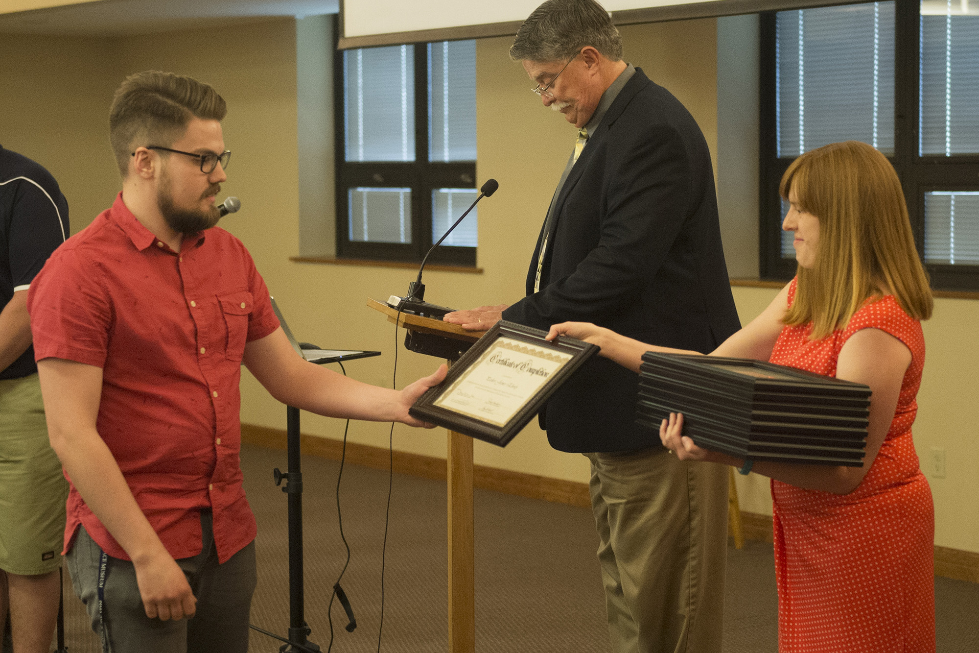 Parker Eberly '16 (Narvon, Pa.) receives a certificate of completion for the aviation program.