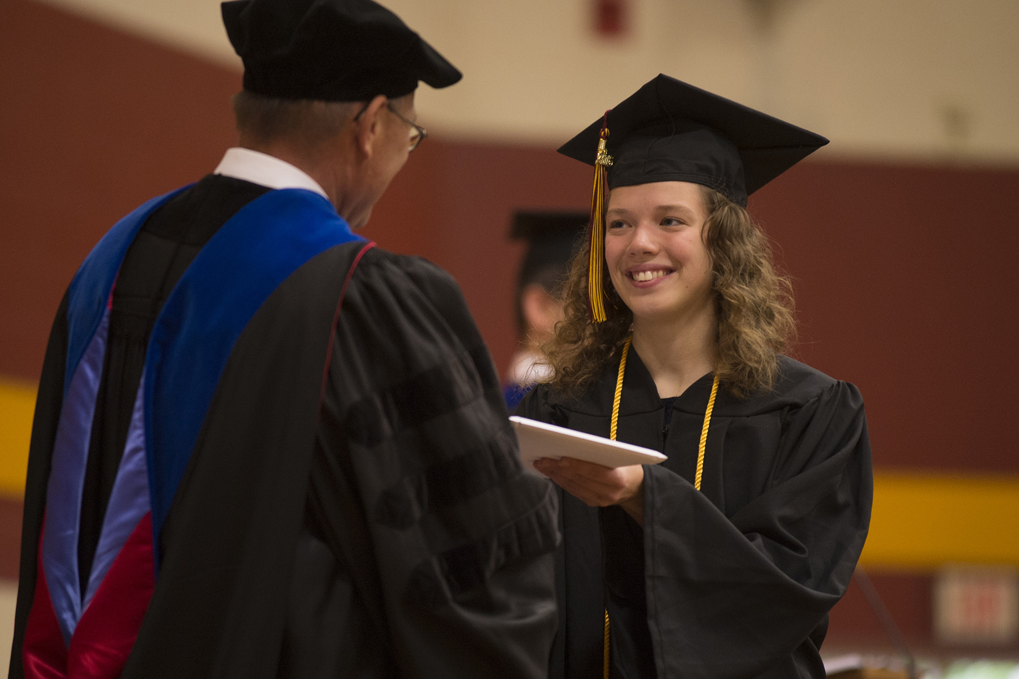 Shelby Miller '16 (Archbold, Ohio) receives her diploma from President Howard Keim.