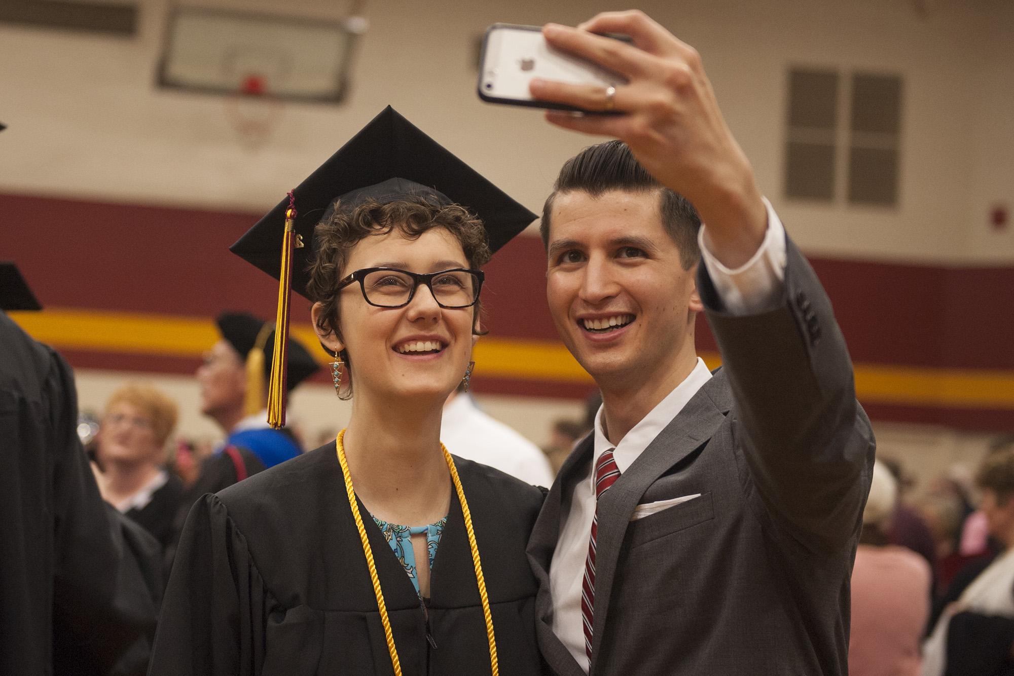 RaeLee Hightower '16 (Tulsa, Okla.) takes a selfie with English instructor Donovan Tann.