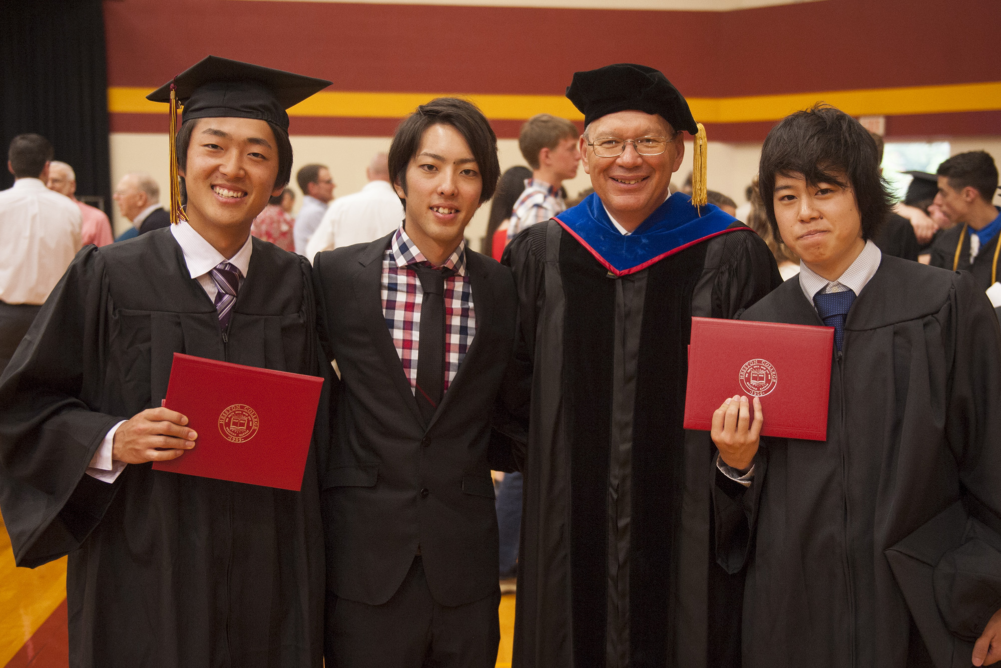 President Howard Keim '72 celebrates with (from left) Yuki Torii '16 (Nishio, Japan), Satoshi Hoshino '16 (Saitama-ken, Japan) and Shimon Shike '16 (Iwaki, Japan).