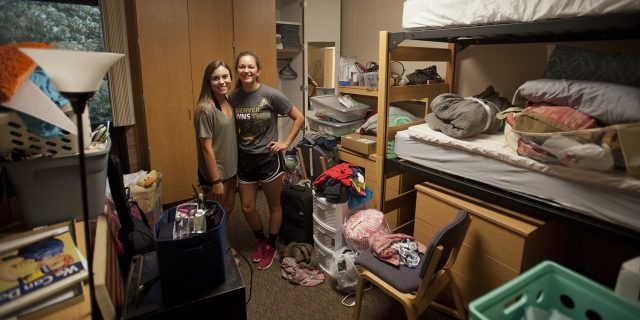 Freshmen Kendall Richardson (Lodi, Calif.) and Jasmine Pankratz (Abbyville, Kan.) take their first roommate picture shortly after moving into their dorm room Aug. 19.