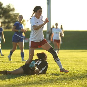 Hesston College women's soccer player Kenzie Johnson scores in a match with Bethany College JV