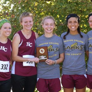 HC women's cross country team poses with the first place plaque at the Bethel Invitational meet