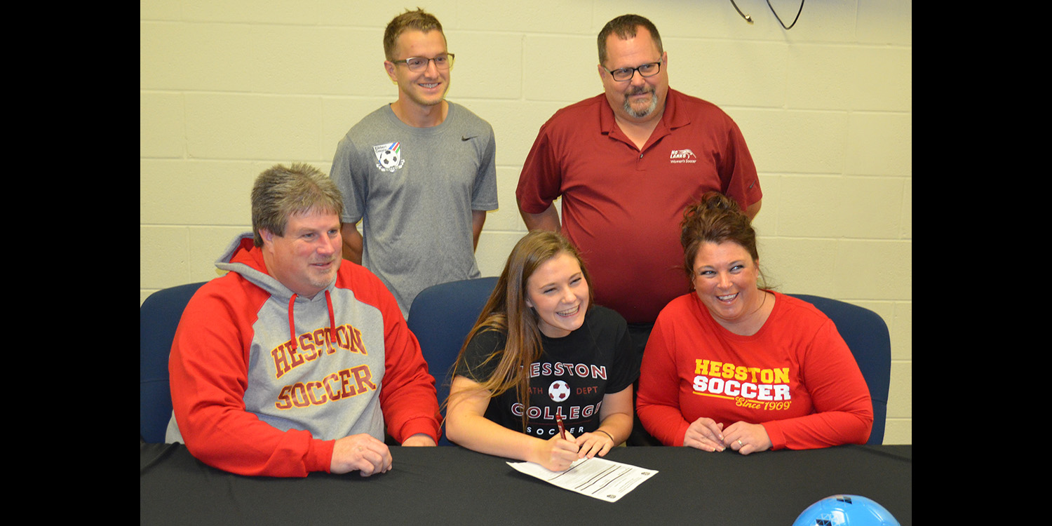 Morgan Lantz signs a letter of intent to play women's soccer at Hesston College.