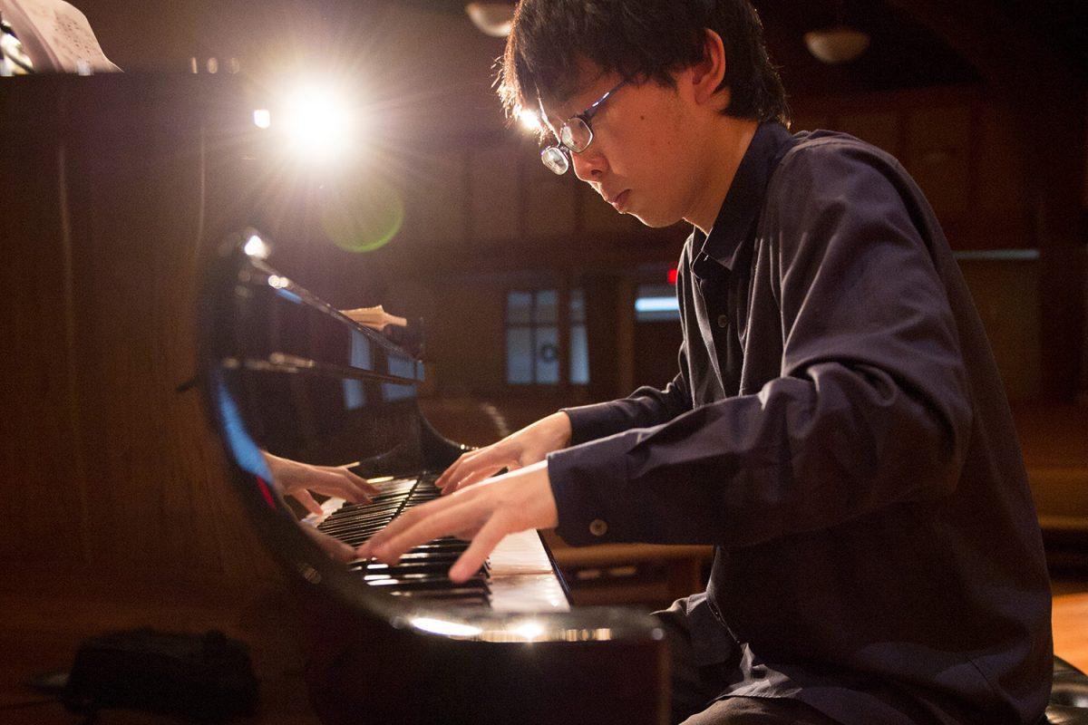 Masataka Miyake practices piano