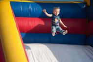 Future Lark Ty Martin, son of Steve '04 and Kristi Martin, goes airborne on an inflatable slide at the family festival.