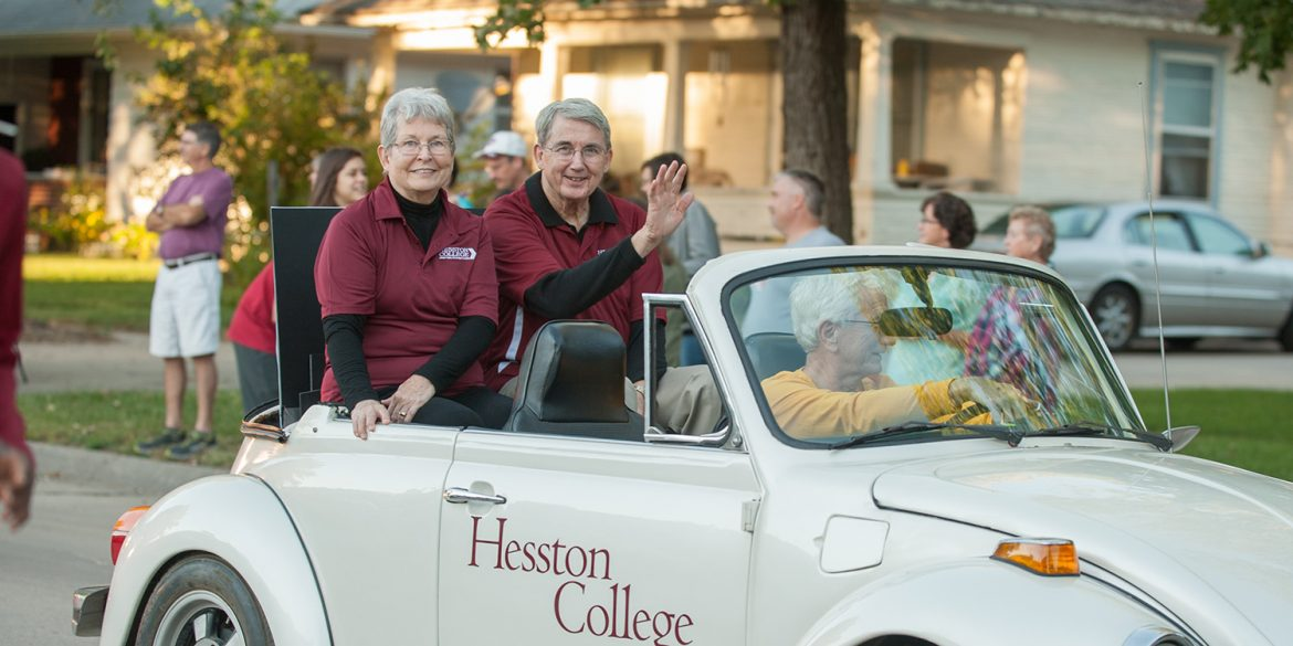 Interim President Ben Sprunger and his wife, Sue, ride in the community-wide Homecoming parade.