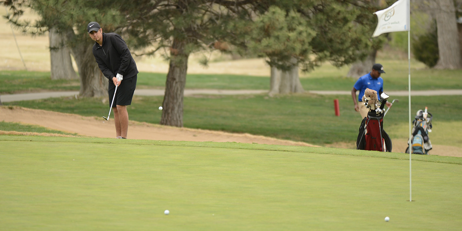 Hesston College golf action photo