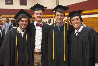 Four graduates at Hesston College Commencement 2016