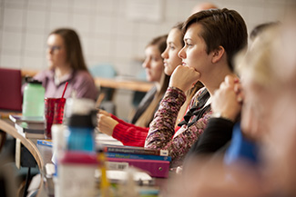 Nursing students listen in class