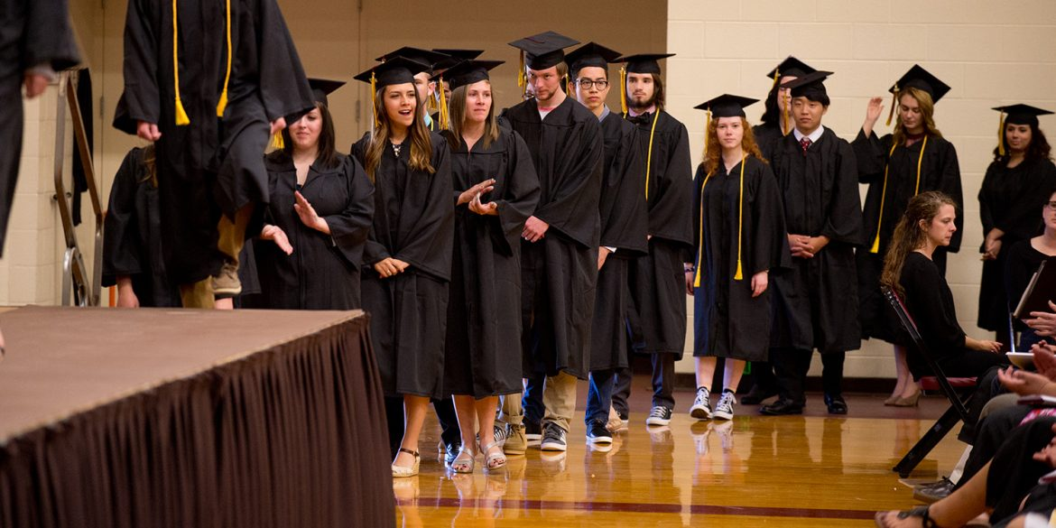 Graduates of the class of 2017 wait to receive their diplomas at Commencement.