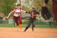 HC softball shortstop Sierrah Long tags a Ft. Scott baserunner.