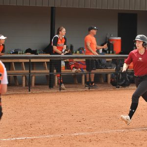 Softball action photo - Taylor Martin heads home to score the Larks only run of the day.