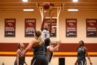 HC women's basketball player Whitney Green elevates for a shot.