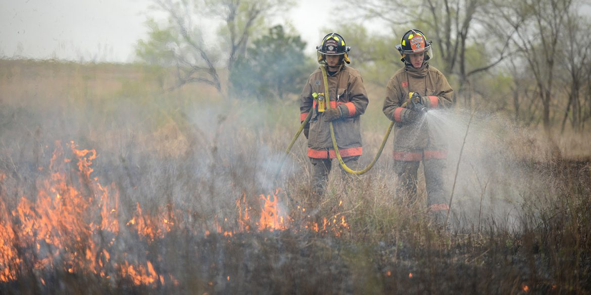 Hesston College EMS-fire students assist with a controlled burn