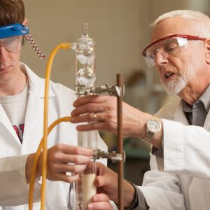 Chemistry prof Jim Yoder works with a student in the organic chemistry lab.
