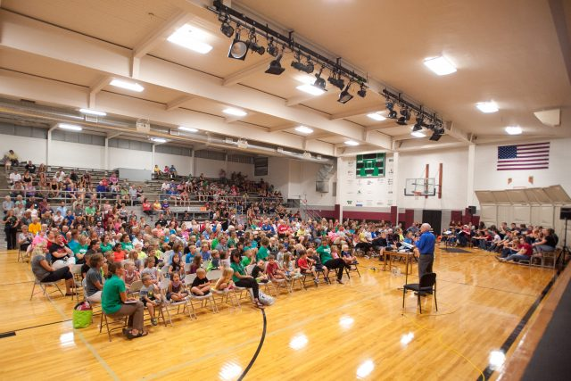 Hesston College chemistry professor Dr. Jim Yoder and the Bel Canto Singers present an eclipse program to a crowd of about 450 at Shickley (Neb.) Public School. Groups involved in the day included Hesston College science, math and education students, faculty and staff, Shickley Public School students in grades PreK-12, faculty and staff, Hesston College alumni and friends, and members of the community of Shickley and Salem Mennonite Church (Shickley).