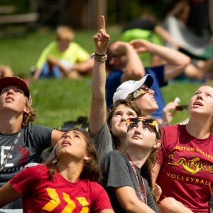 Hesston College students view the totality of the solar eclipse.