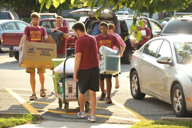 Hesston College resident assistants (clockwise from front) Garrett Roth (Hesston, Kan.), Angus Siemens (Newton, Kan.), Curtis Oesch (Caldwell, Idaho) and Keegan Cook (Whitewater, Kan.) help a new student move into the dorms during one of the move in times throughout the week leading up to Opening Weekend.