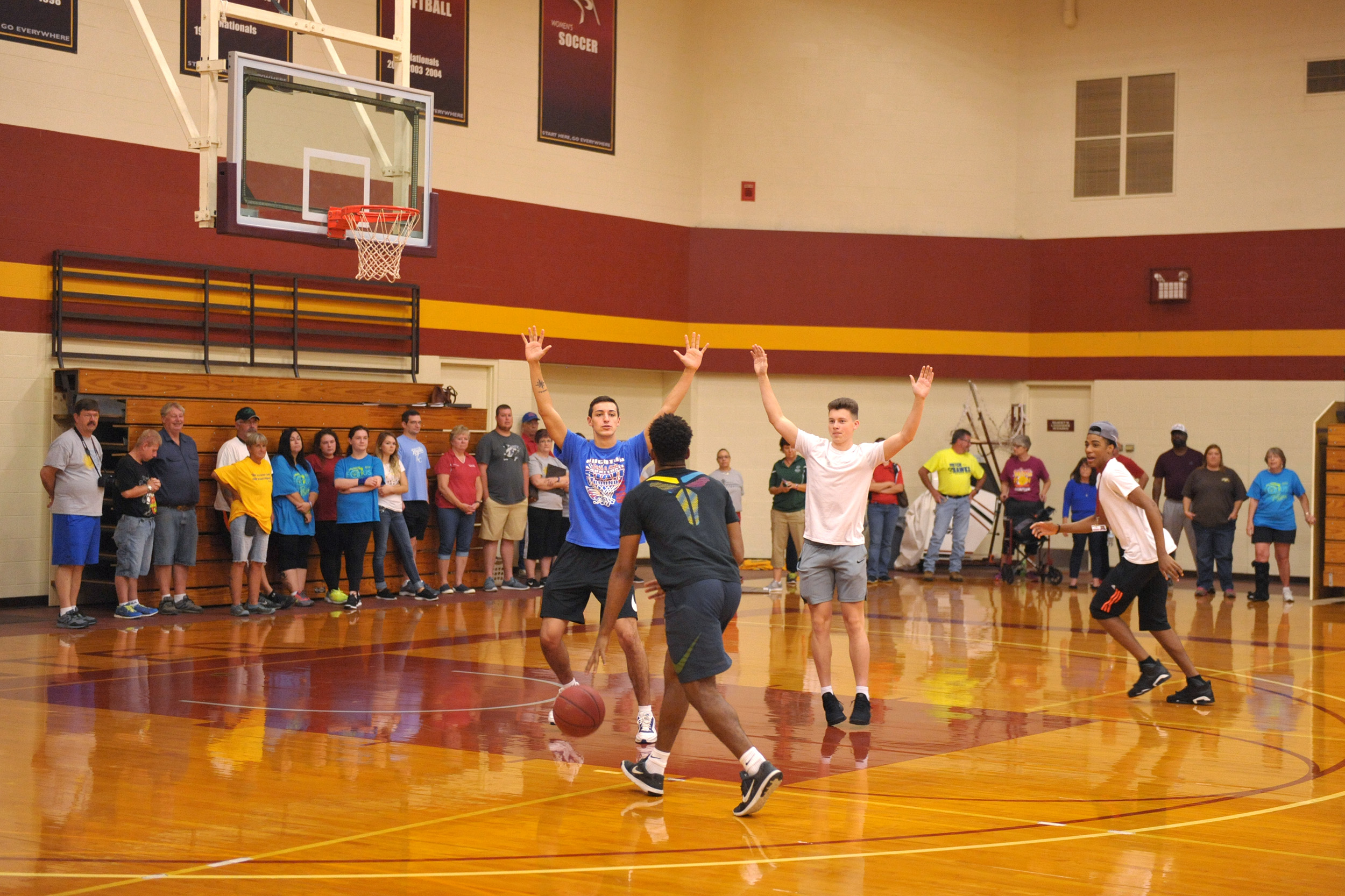 Hesston College men's basketball players demonstrate drills at a clinic for prospective Special Olympics coaches.