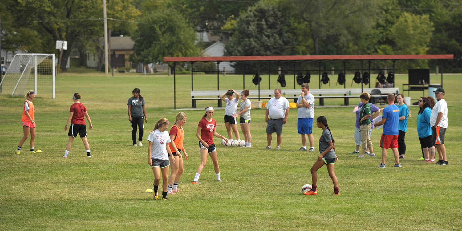 Hesston College women's soccer players demonstrate drills at a clinic for prospective Special Olympics coaches.