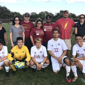 HC men's soccer sophomores pose with parents on sophomore night