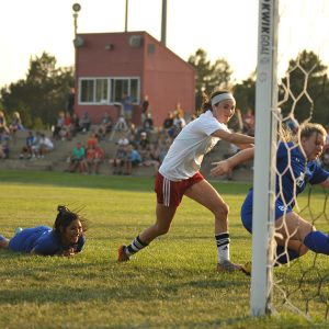 Hesston College women's soccer player Kenzie Johnson scores in a September 9, 2017 match with Pratt Community College.