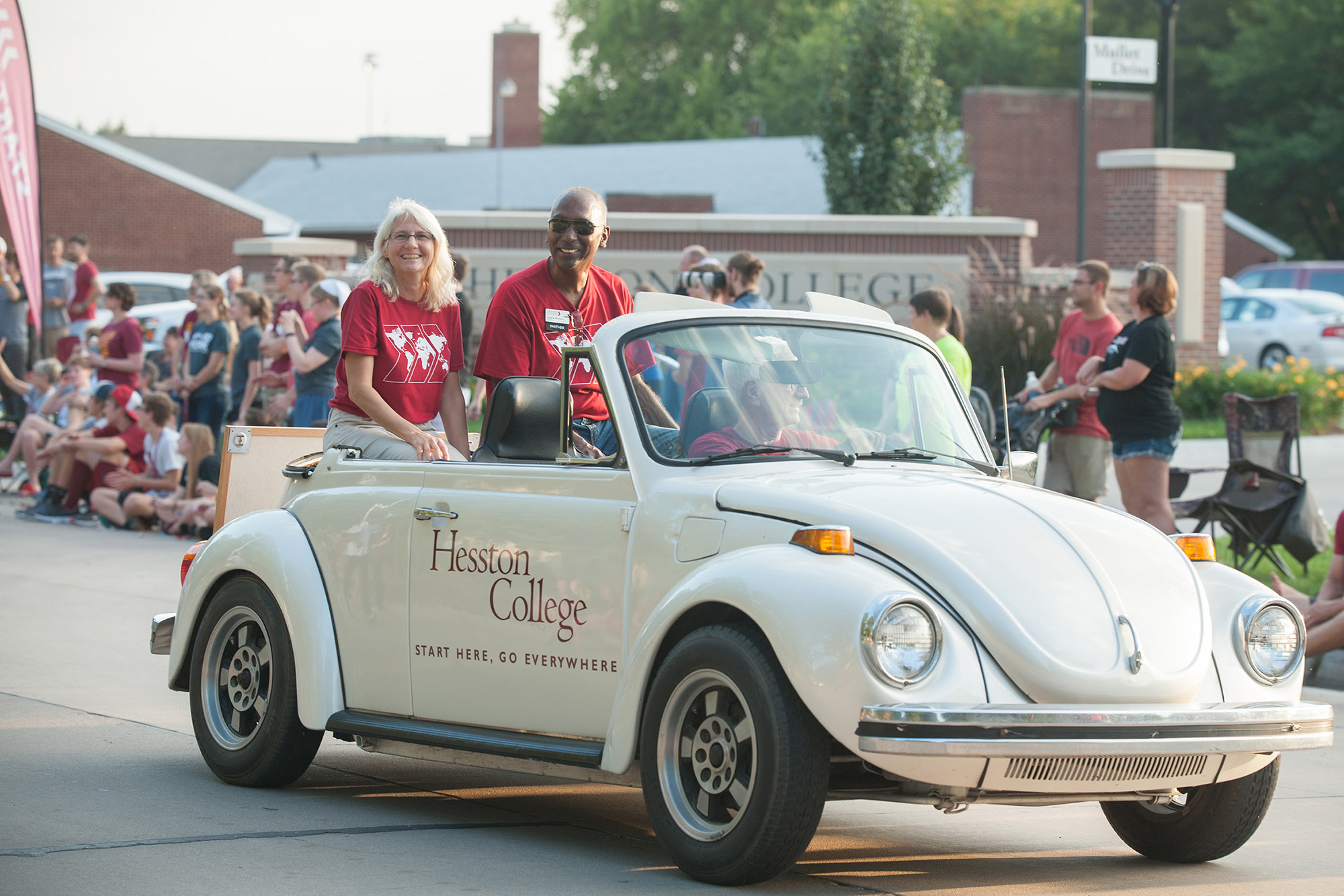 President Joe and Wanda Manickam ride in the Hesston College Beetle in the homecoming parade