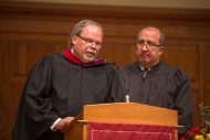 Hesston College Board of Directors Chair Kelvin Friesen and Mennonite Education Agency Executive Director Carlos Romero speak at the inauguration service.