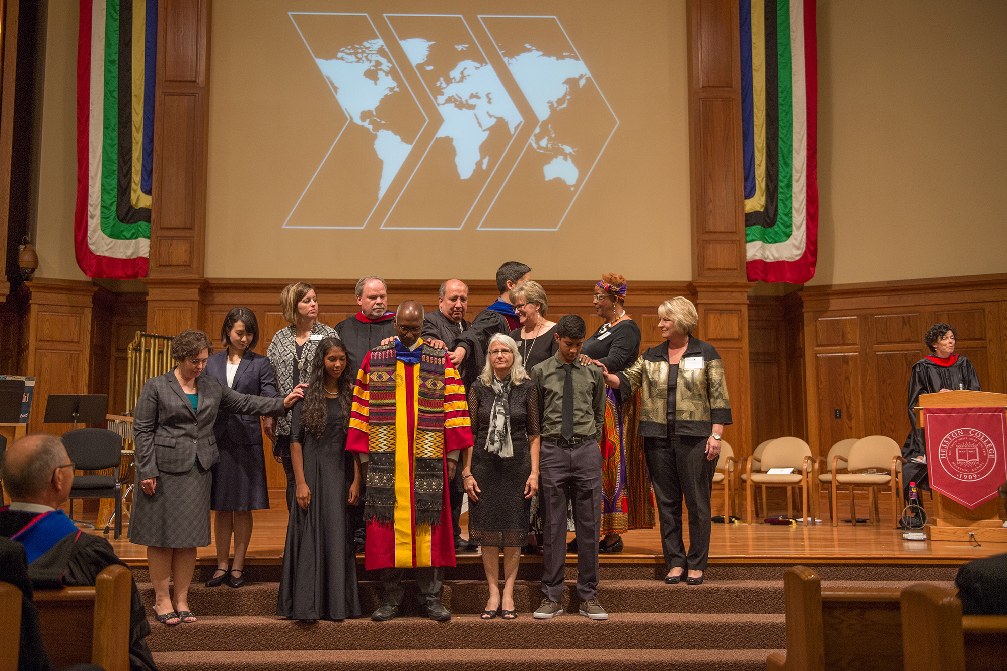 Faculty, staff, students, alumni and representatives of a variety of organizations bless the Manickam family at the close of the inauguration service.