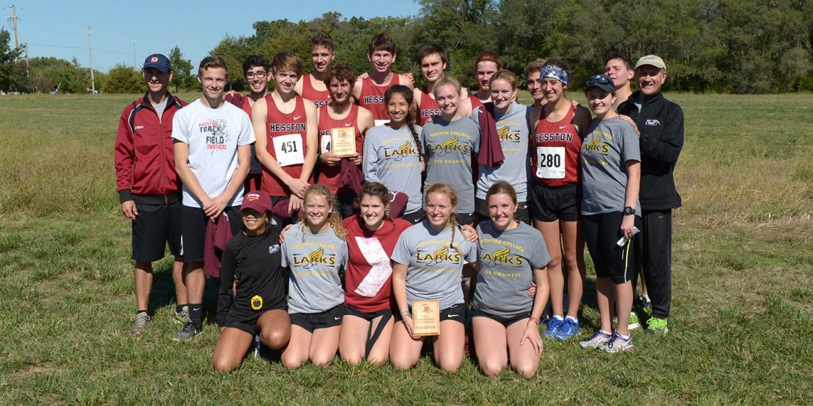 Hesston College men's and women's cross country teams display their team champions plaques after the Bethel Invitational meet, Oct. 7, 2017
