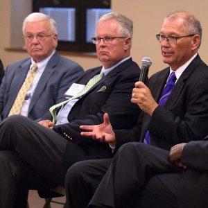 Former Hesston College presidents Laban Peachey, Kirk Alliman and Howard Keim visit with new president Joe Manickam