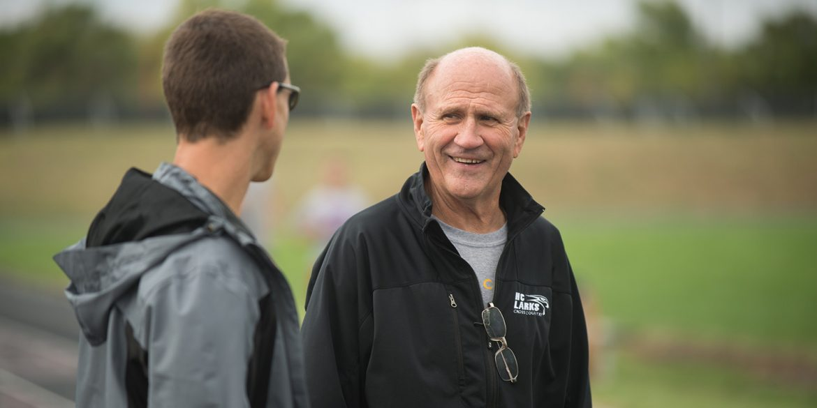 Coach Gerry Sieber visits with assistant coach Todd Lehman at cross country practice