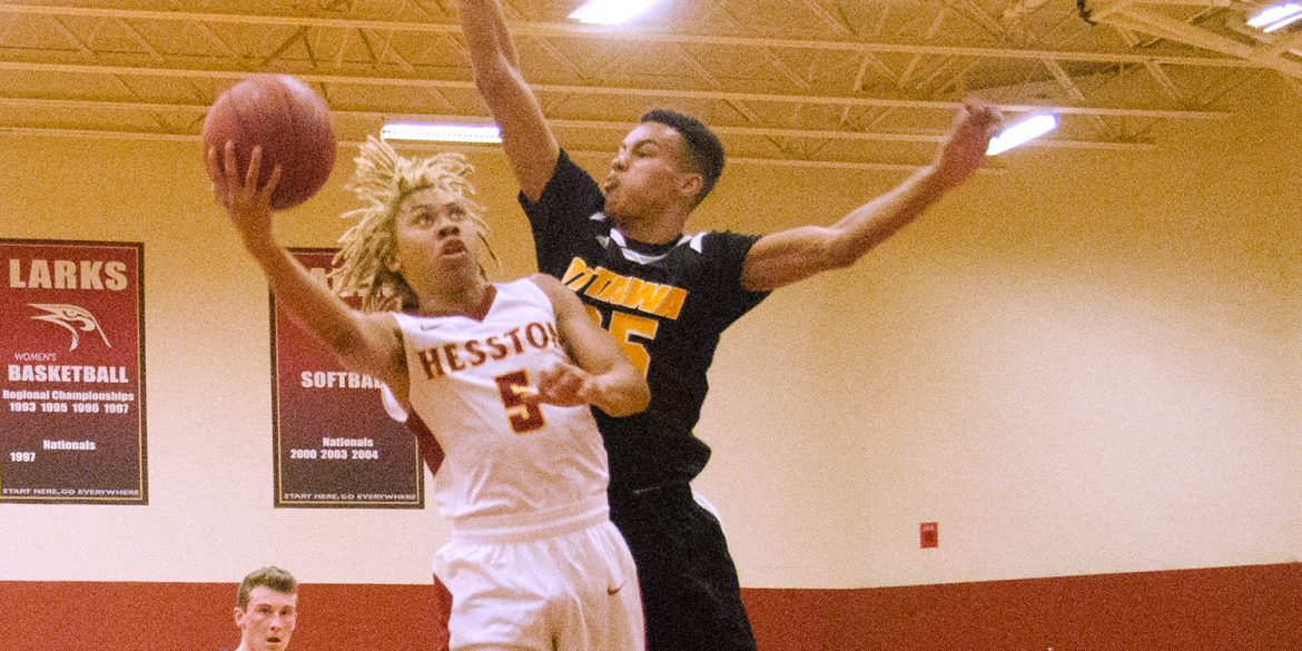Coye Campbell drives the lane in a Hesston College game with Ottawa University JV.