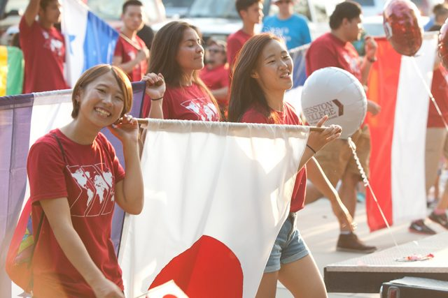 Japanese students Rio Mori '19 and Risa Fukaya '19 represent their countries and Hesston College along with other international students in the community Homecoming parade in September.
