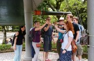 Participants on the Japan trip ring the Hiroshima Peace Bell.