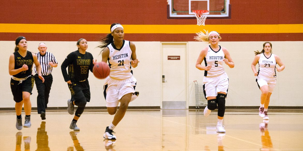 Milaya Bray brings the ball up the court for Hesston College.
