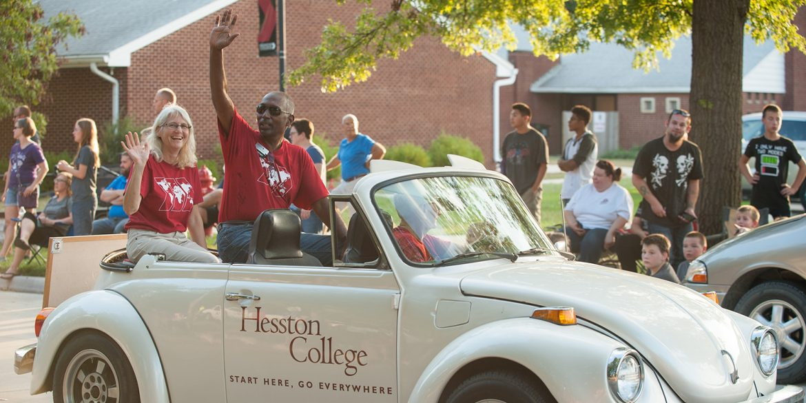 Joe '87 and Wanda (Wyse) '88 Manickam ride in the community-wide homecoming parade.