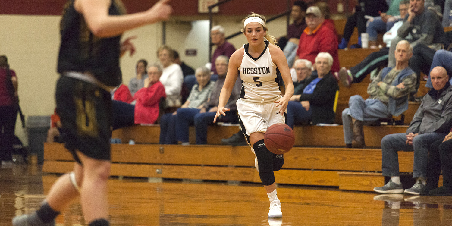 Hunger Begley brings the ball up the court for Hesston College women's basketball.